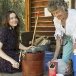Linda Pittman with Johanna Holbrook churning