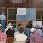 Bob Dunkley explains Park plans for the Polebridge Ranger Station, post Red Bench Fire, at the 1989 Interlocal at Sondreson Hall.